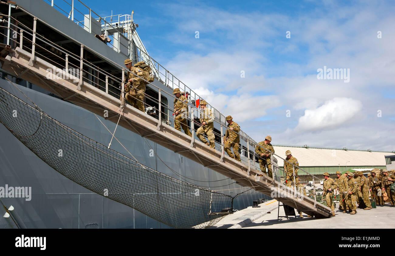 Australian soldiers with the 2nd Battalion, Royal Australian Regiment embark aboard the Royal Australian Navy dock landing ship - Stock Image