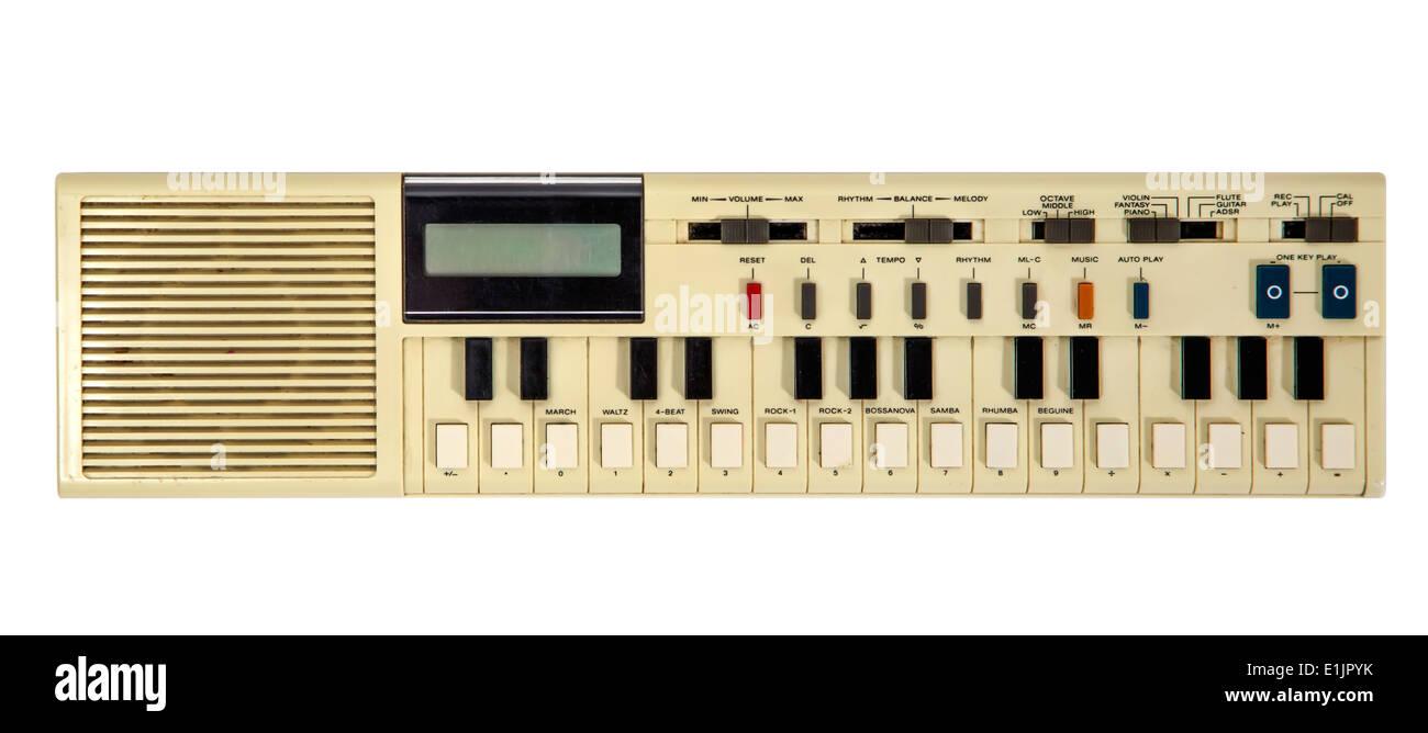 Old vintage synthesizer isolated on white - Stock Image