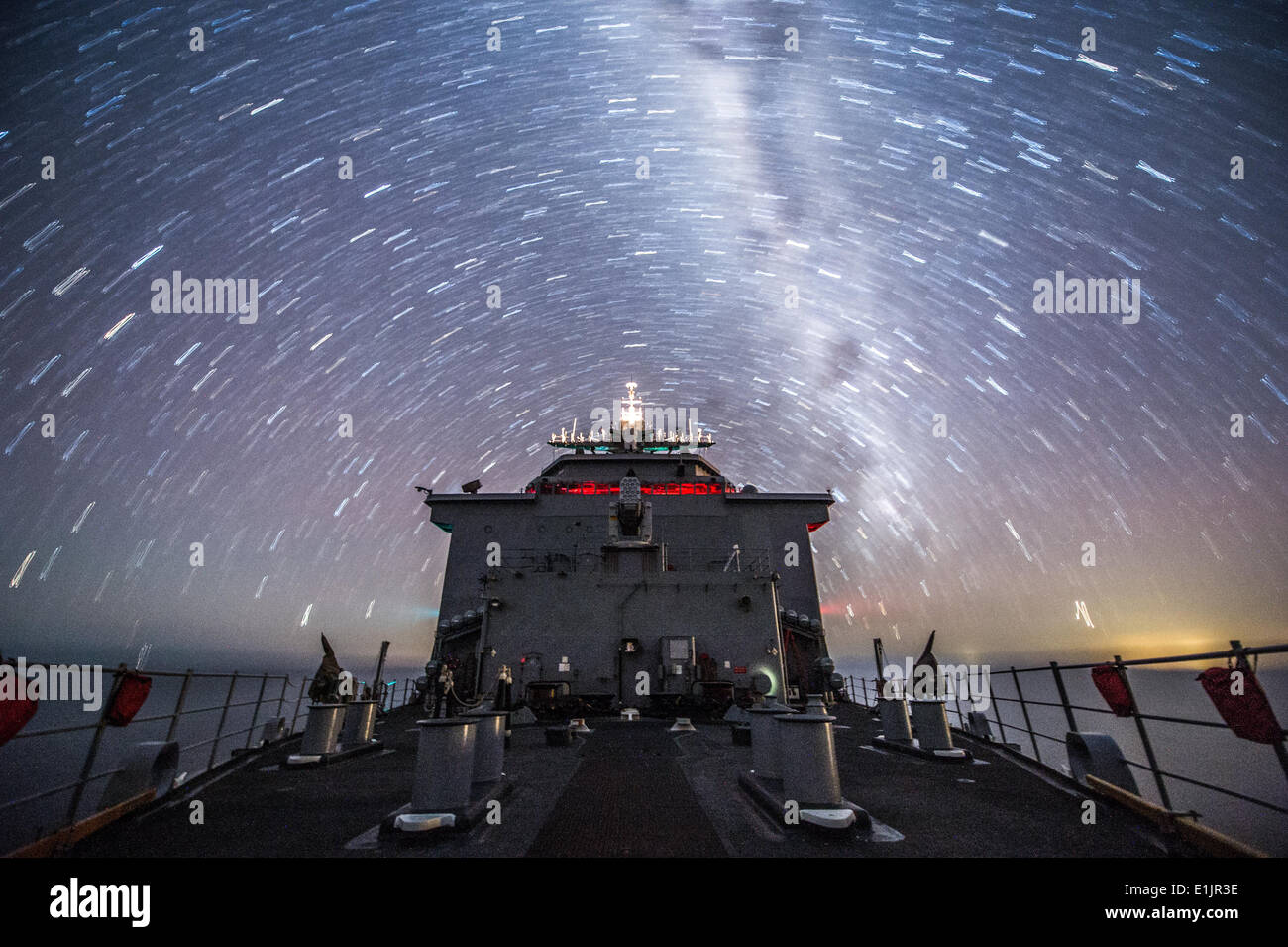 The amphibious dock landing ship USS Germantown (LSD 42) transits the Coral Sea Aug. 10, 2013. The Germantown was Stock Photo