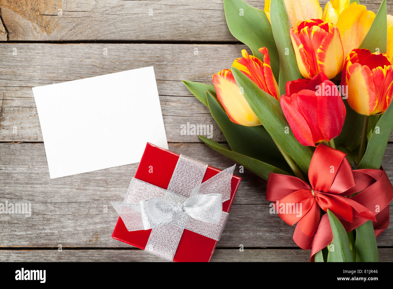 Fresh Colorful Tulips With Gift Box And Greeting Card Over Wooden Background