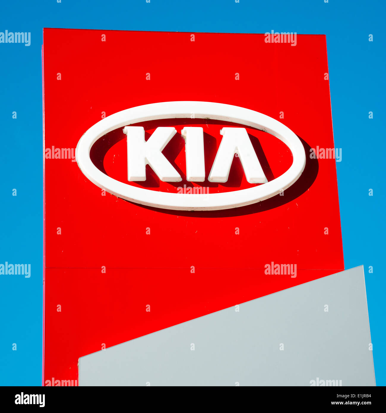 Kia motors sign at a car dealership, UK. Stock Photo