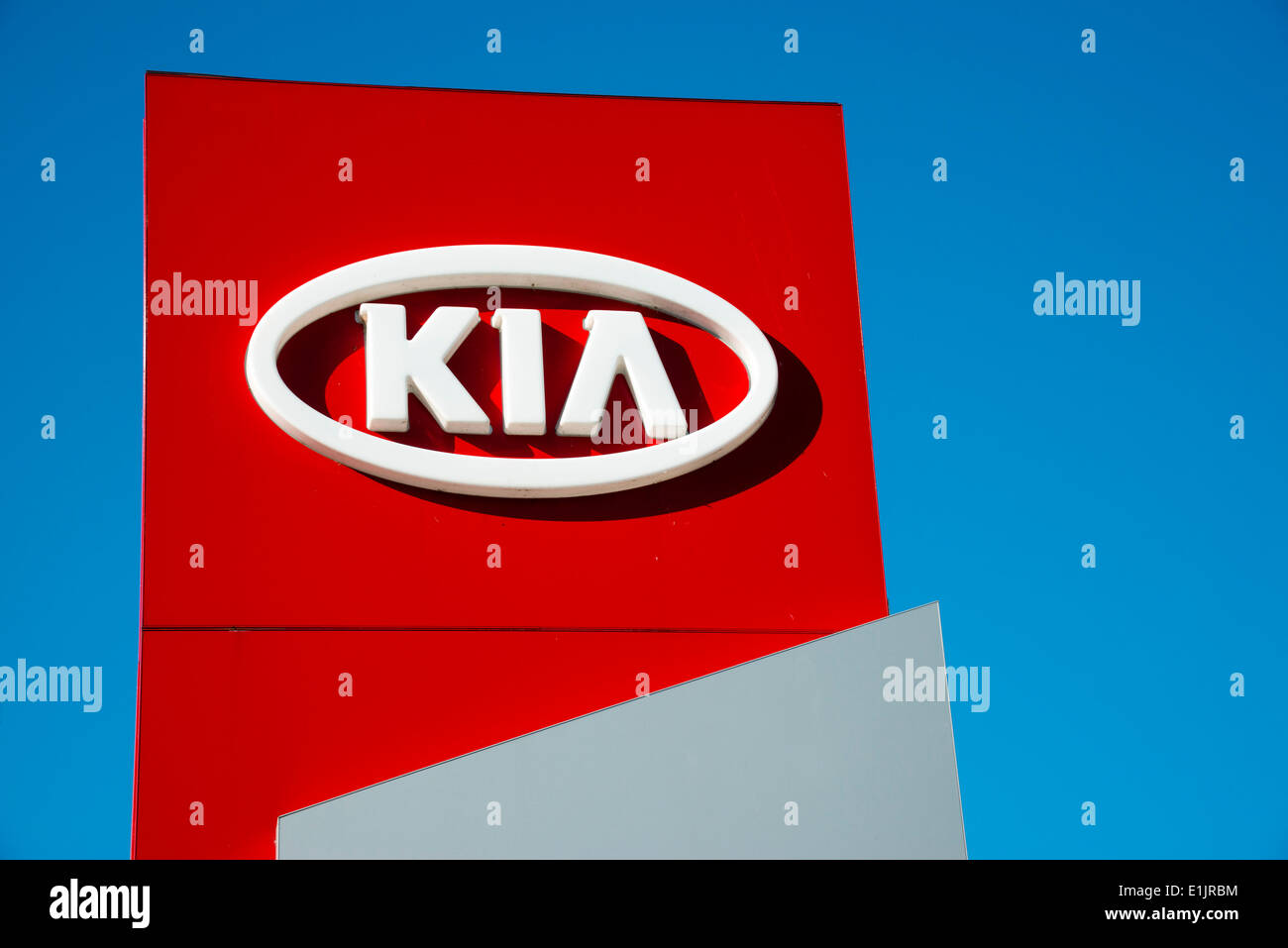 Kia motors sign at a car dealership, UK. - Stock Image