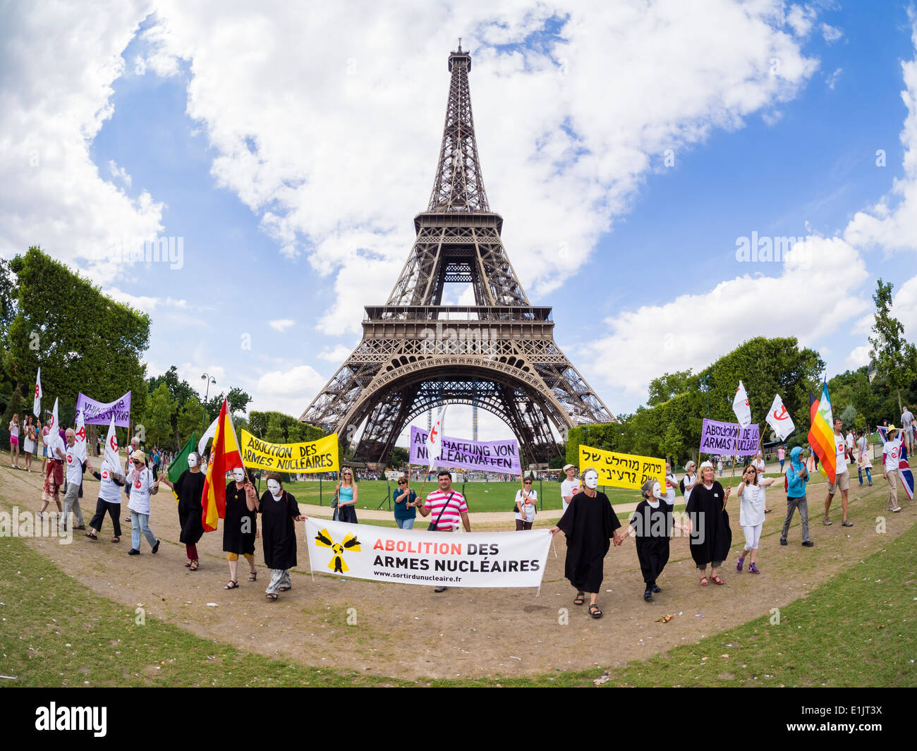 Peace activists from various countries demonstrate for the abolition of nuclear weapons at the Paris Eiffel Tower. - Stock Image