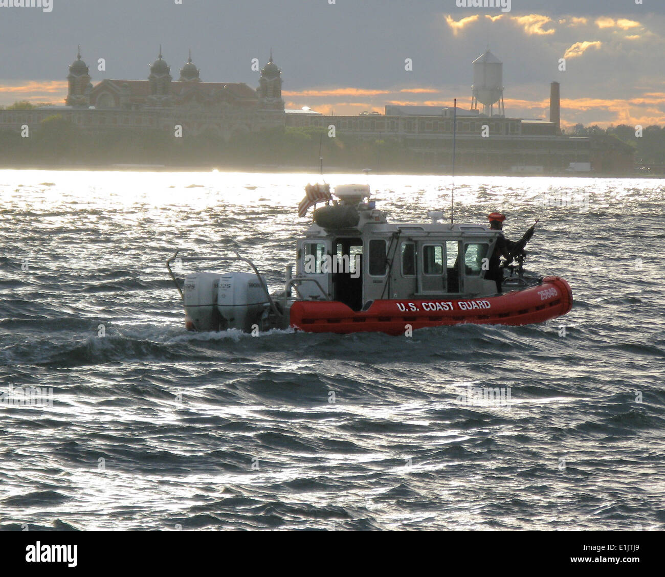 A 25-foot response boat from Coast Guard Station New York underway in New York Harbor at dusk. Developed in a direct Stock Photo