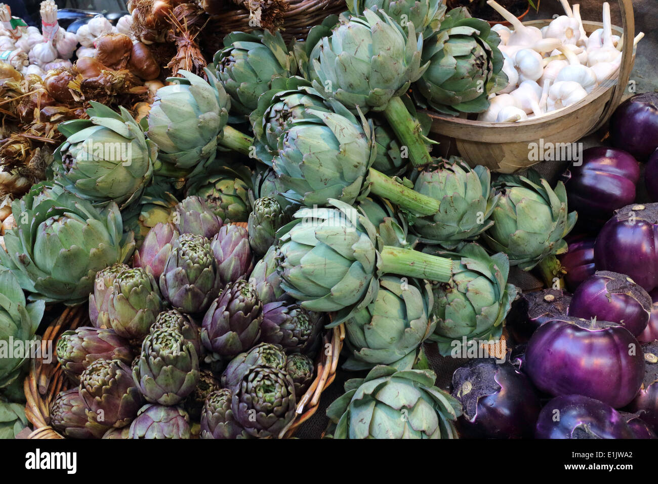 Organically grown Artichoke, Purple Aubergine and Garlic vegetables in the market stall - Stock Image
