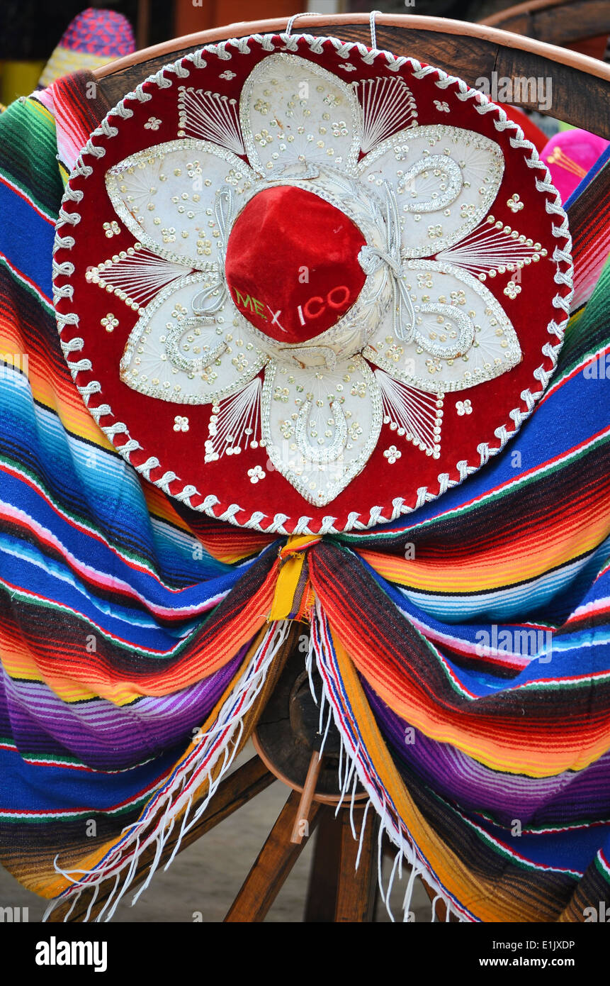 Sombrero and poncho in Mexico - Stock Image