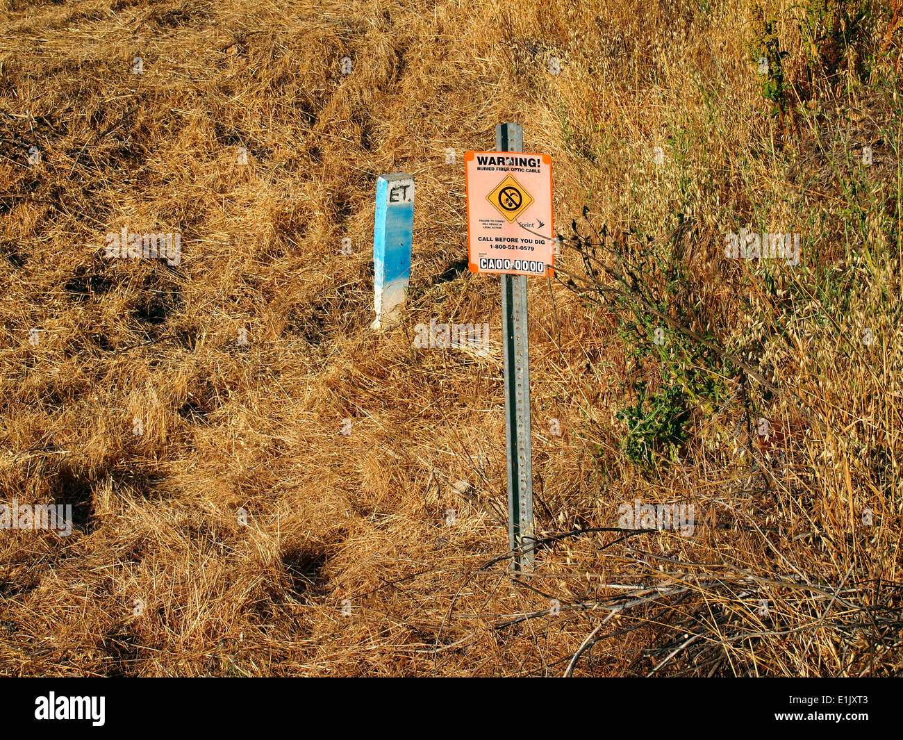 Warning buried fiber optic cable sign marker Fremont California - Stock Image