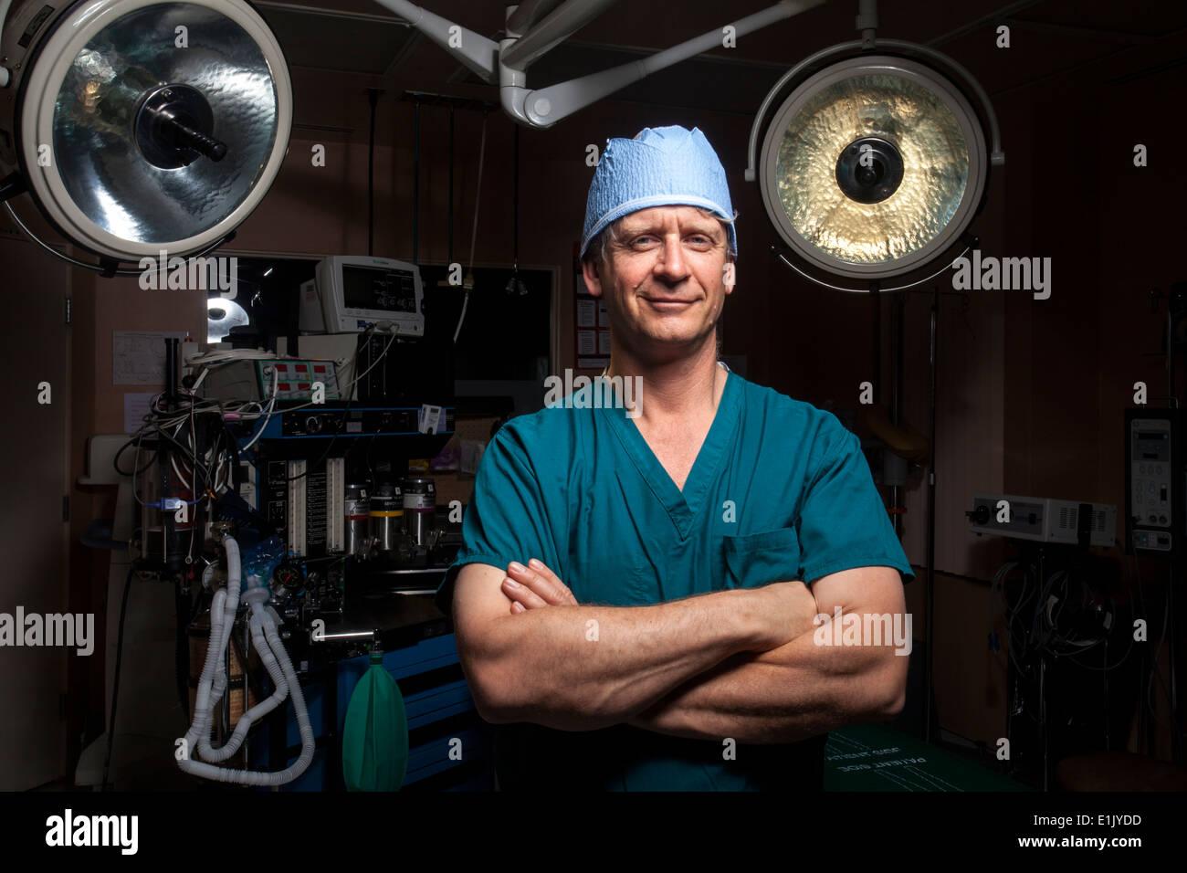 Doctor in white coat in operating room - Stock Image