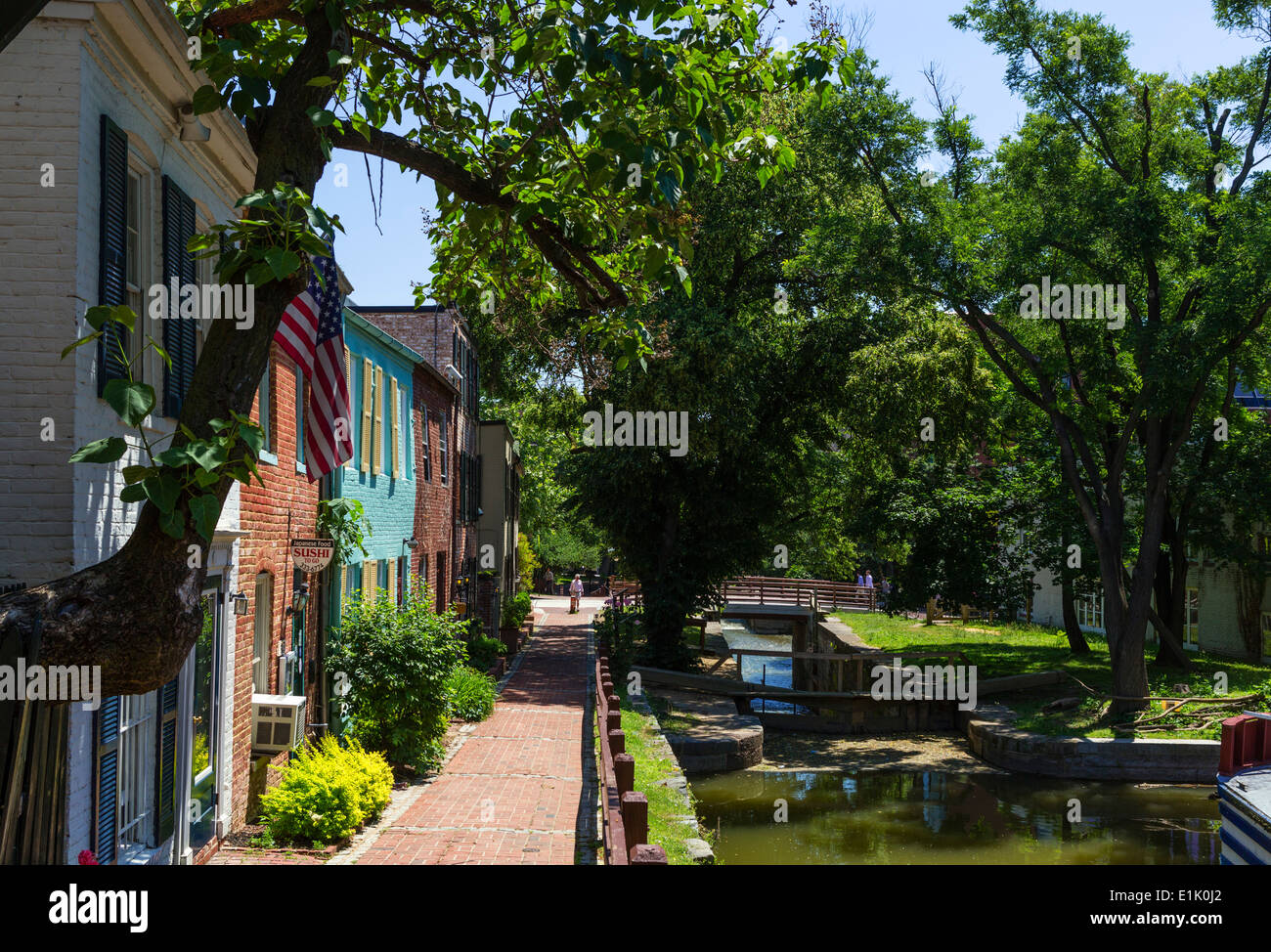 Houses alongside the Chesapeake and Ohio Canal towpath in downtown Georgetown, Washington DC, USA - Stock Image