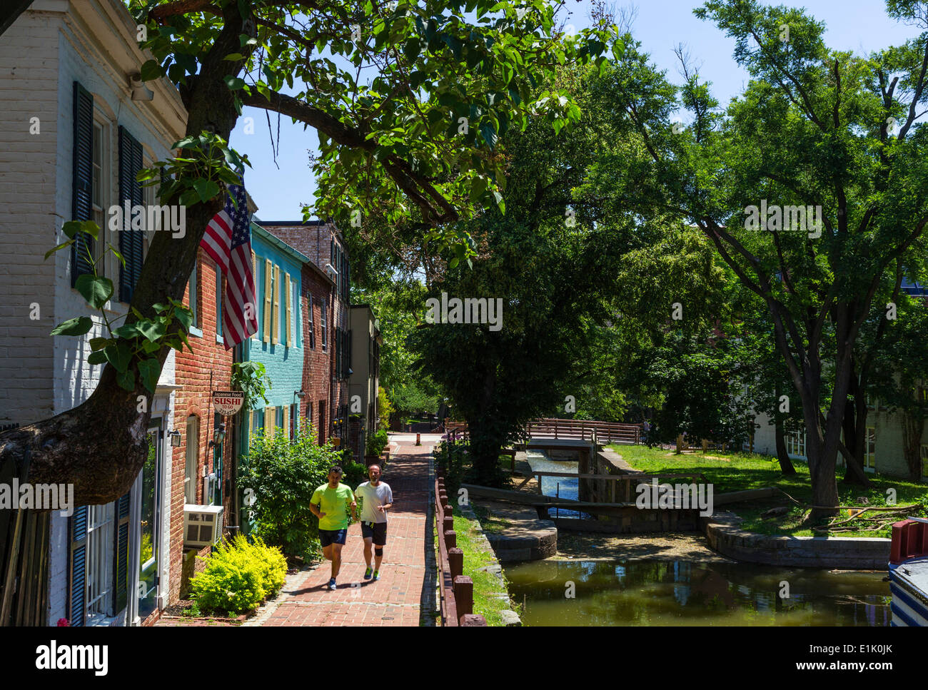Runners on the Chesapeake and Ohio Canal towpath in downtown Georgetown, Washington DC, USA - Stock Image