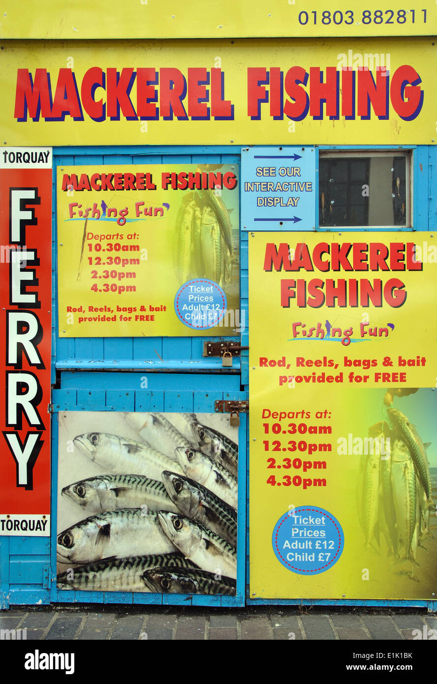 adverts on kiosk for mackerel fishing boat trips, Brixham, Devon, England, UK - Stock Image