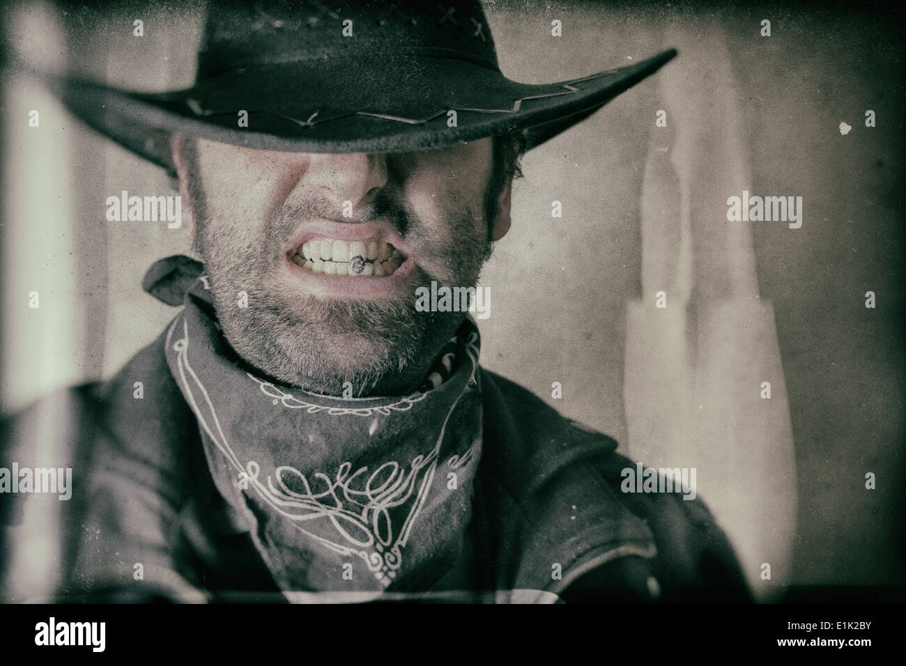 Old West Cowboy Smoker Gritting Teeth - Stock Image