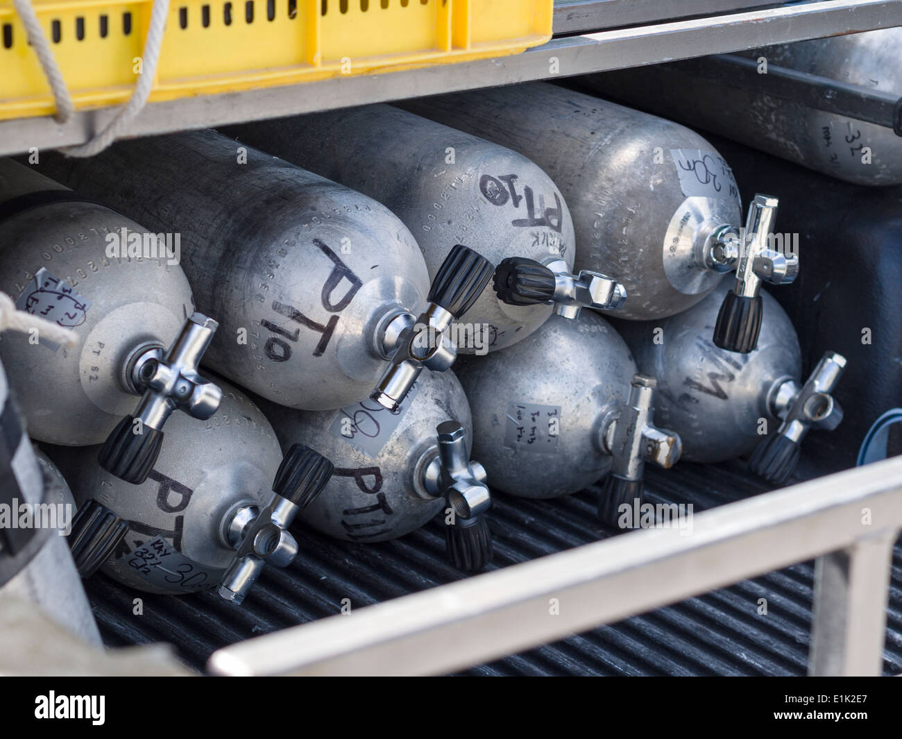 Scuba Diving Tanks. Eight air tanks stacked and ready for transport to a diving boat. - Stock Image