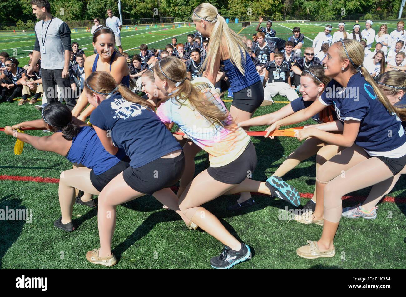 Teen Girls Playing A Tug Of War Game Stock Image