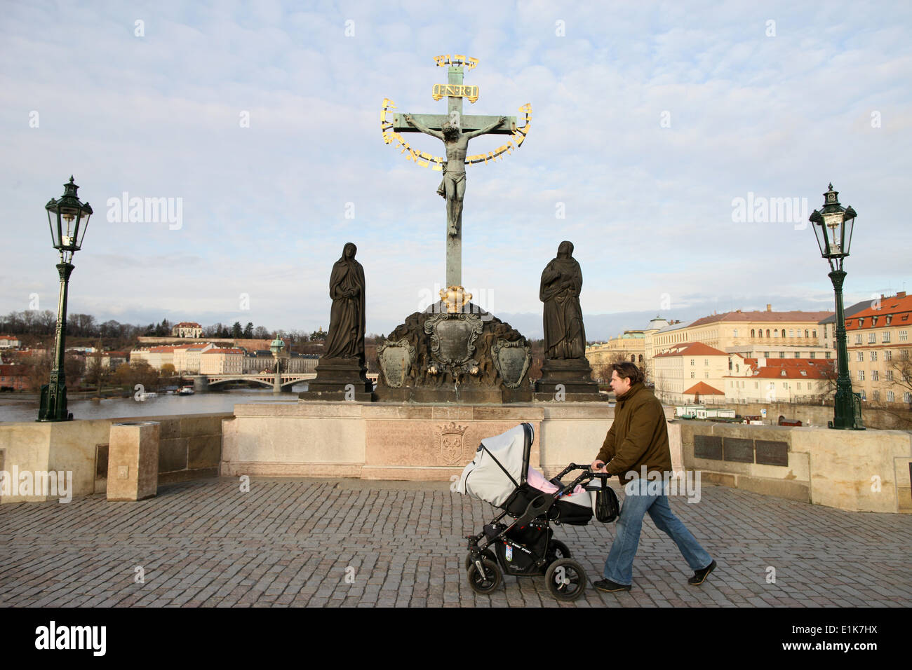 Statue of Jesus on the cross with Hebrew lettering on Charles bridge. - Stock Image