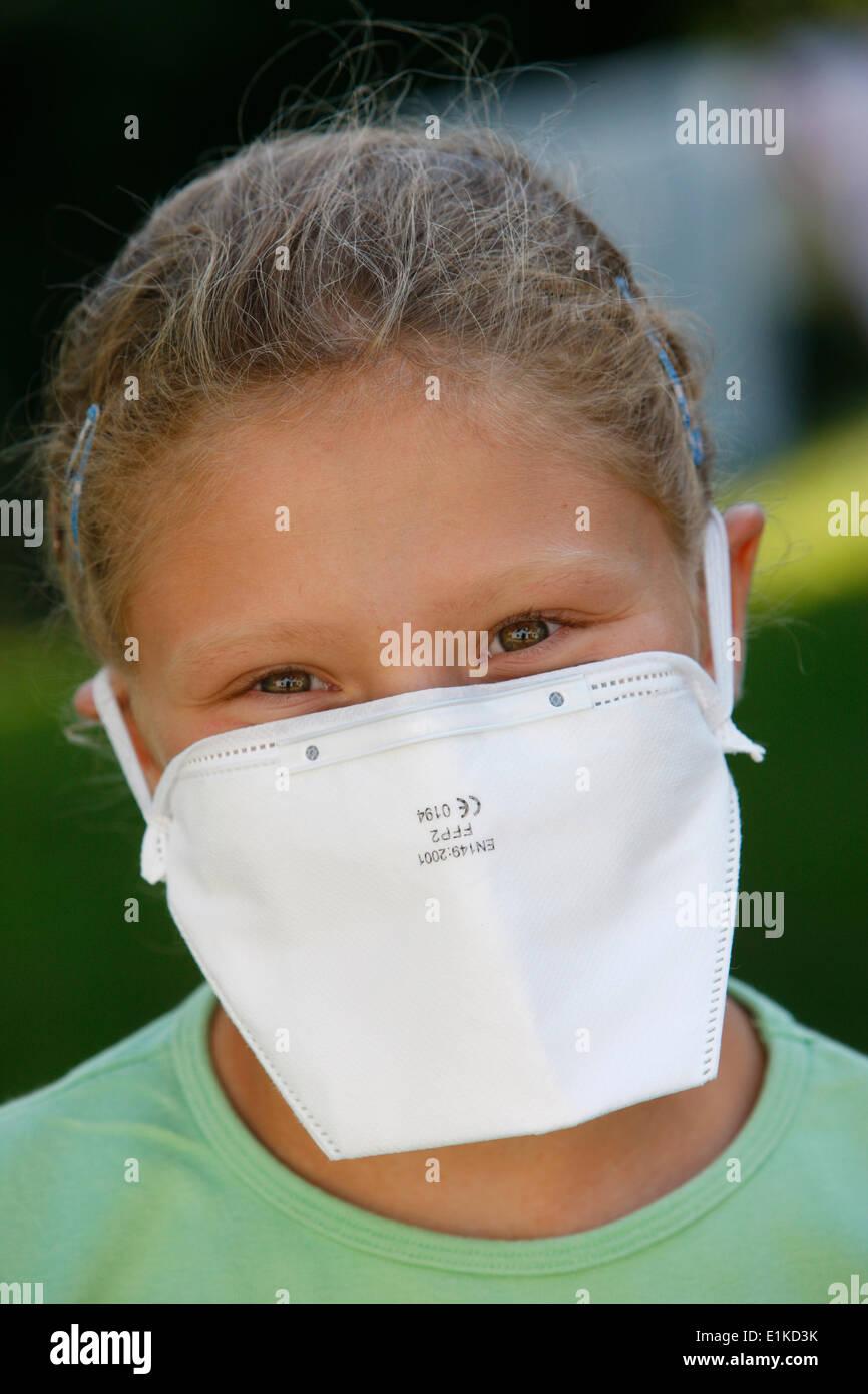 Girl wearing a respiratory mask - Stock Image