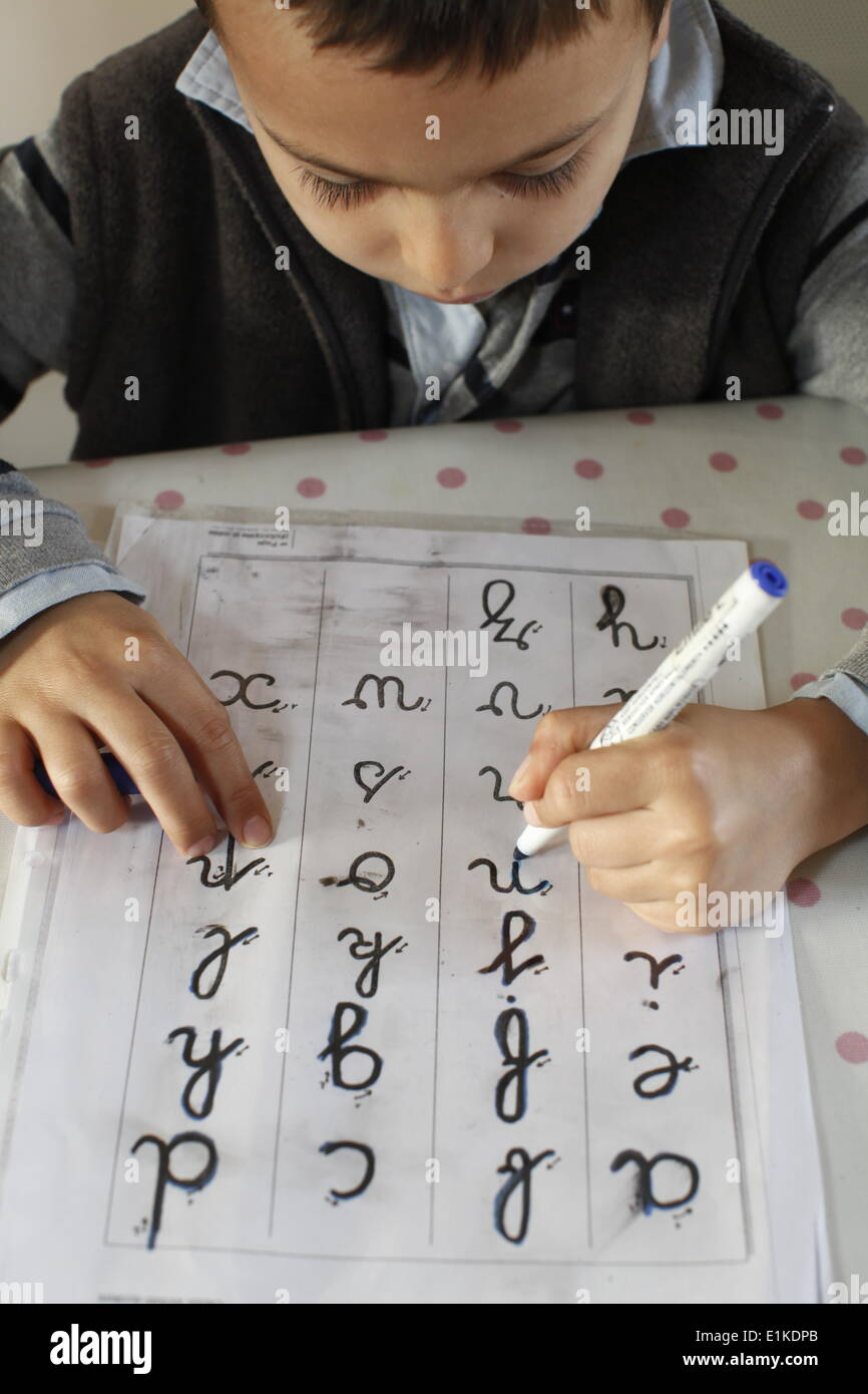 6-year-old boy learning to write letters - Stock Image