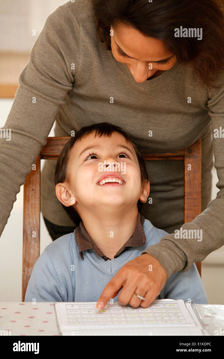 6-year-old boy with his mother - Stock Image
