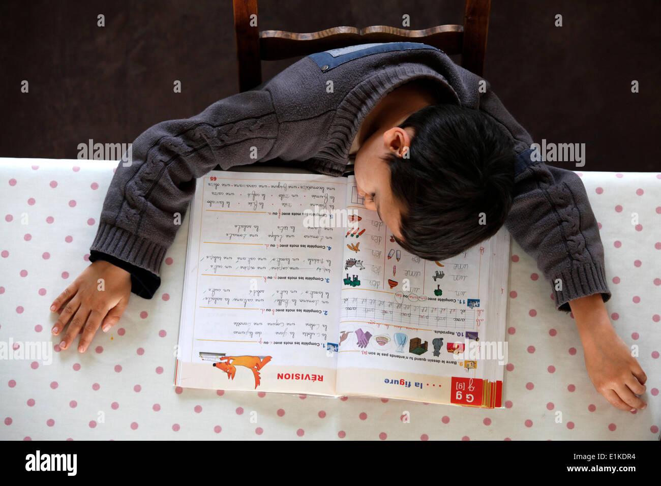 6-year-old boy sleeping on his schoolwork Stock Photo: 69884056 - Alamy