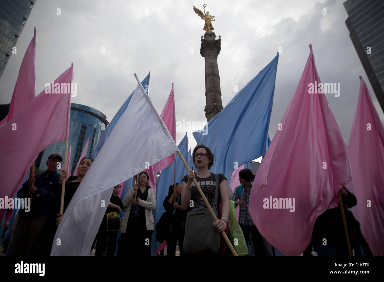 Mexico City, Mexico. 5th June, 2014. People hold flags during a rally in Mexico City, capital of Mexico, June 5, Stock Photo