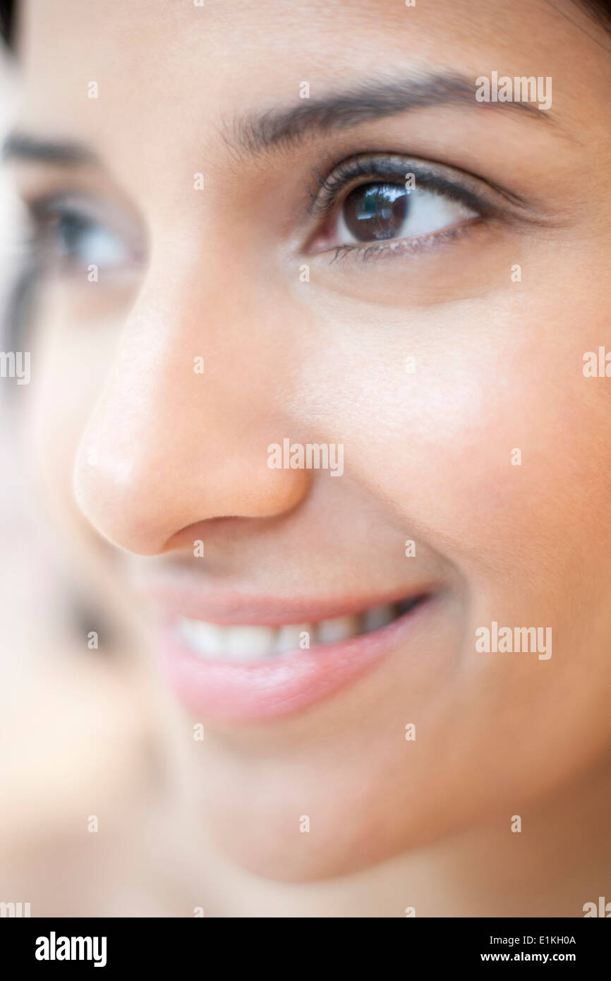 MODEL RELEASED Close up portrait of a woman smiling. - Stock Image