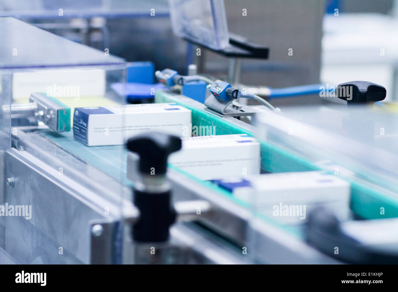 Drugs on a production line in a pharmaceutical production plant. - Stock Image
