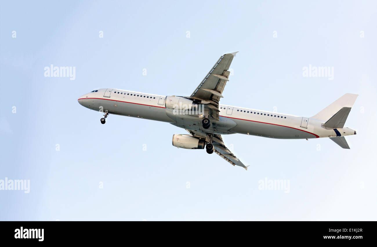 Passenger aeroplane in flight. - Stock Image