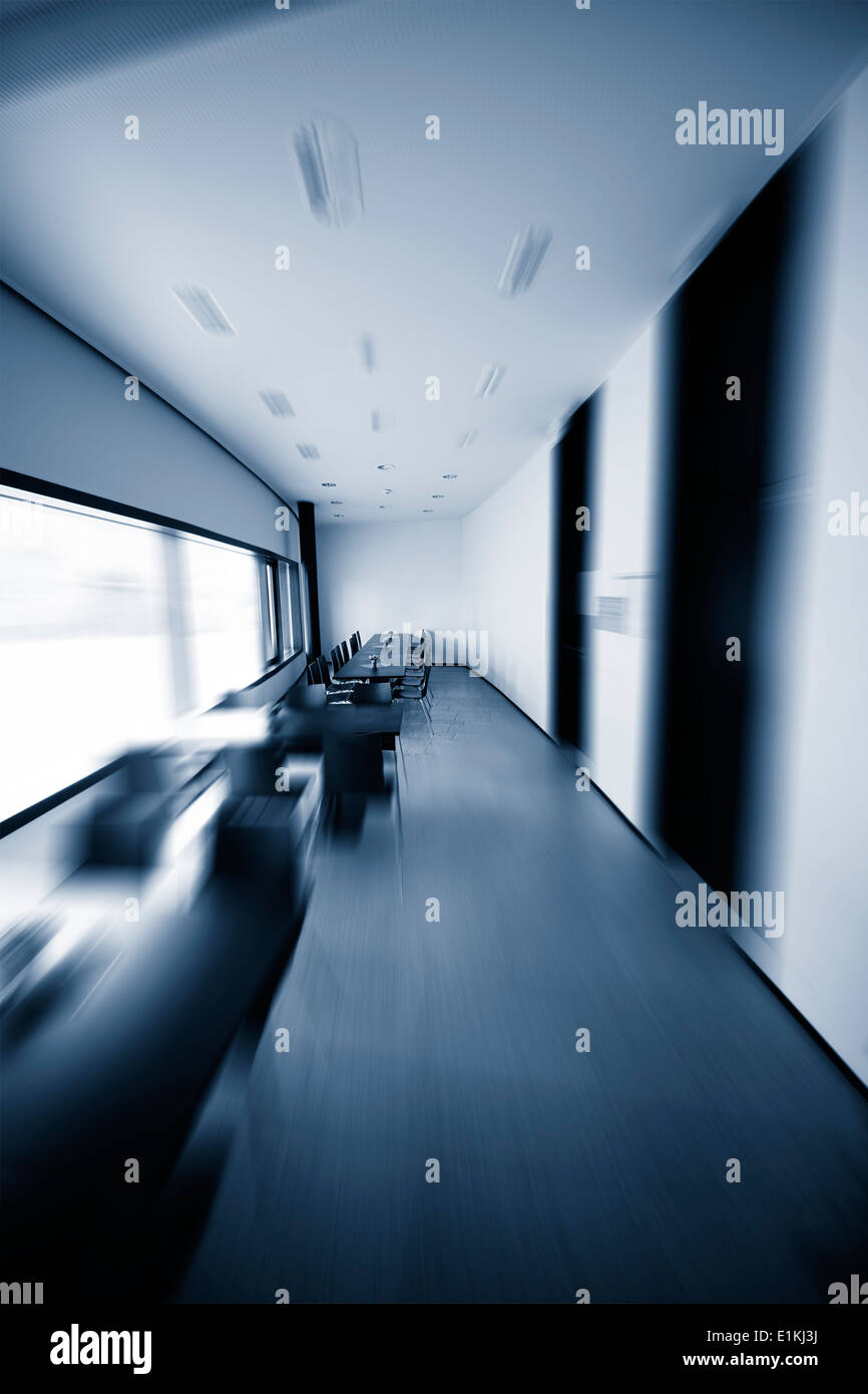 Corridor inside an office building blurred motion. - Stock Image