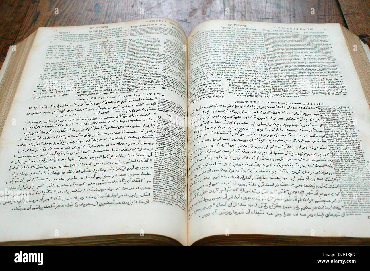 Bible in Hebrew, Latin and Arabic Stock Photo