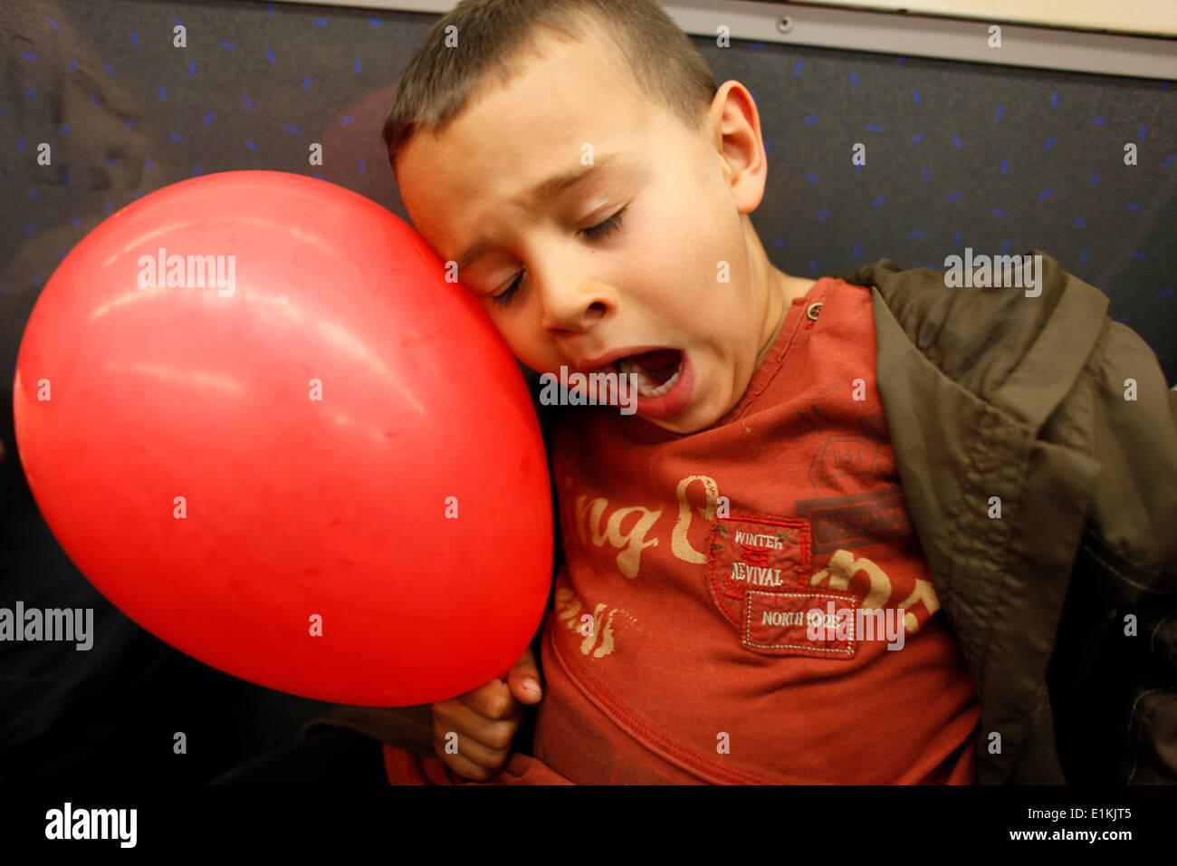 5-year-old boy falling asleep in public transport - Stock Image