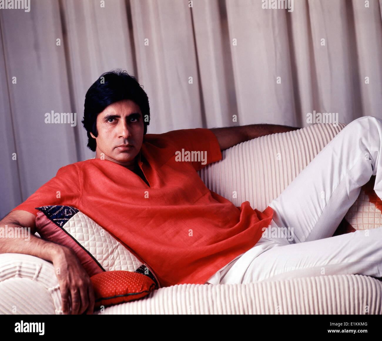 Amitabh Bachchan Indian bollywood actor sitting on sofa 1987 - Stock Image