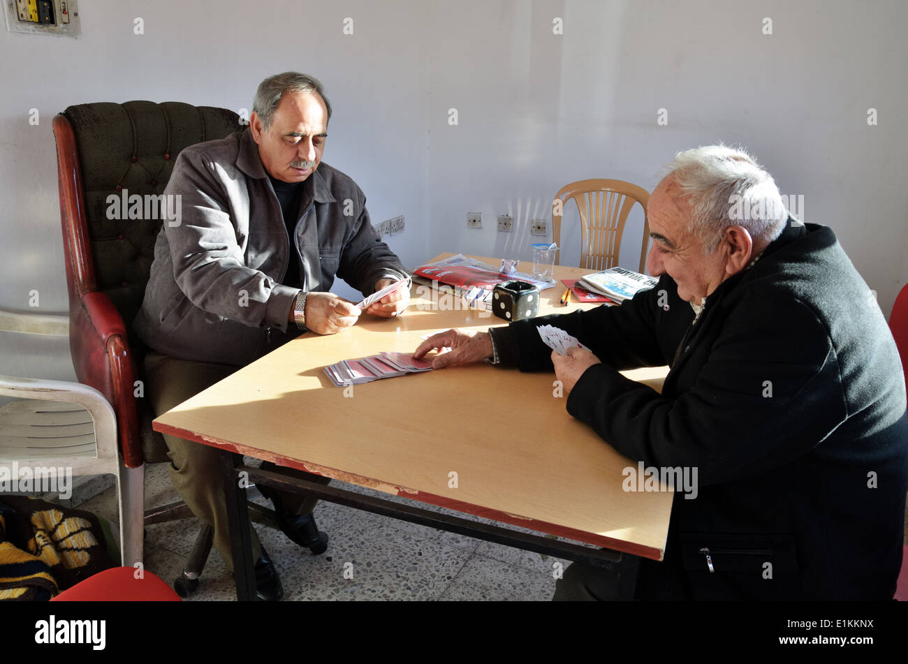 Senior men play cards in Lefka, Northern Cyprus - Stock Image