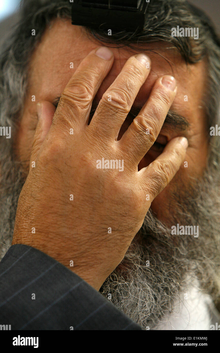 Praying Jew : Shema Israel prayer gesture - Stock Image