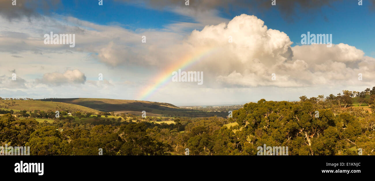 Amazing rainbow with huge clouds over Victor Harbour, on South Australia's Fleurieu Peninsula - Stock Image