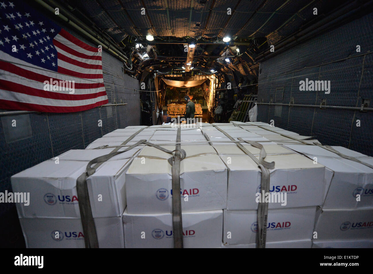 U.S. Airmen assigned to the 1st Special Operation Squadron unload U.S. Agency International Development supplies from an MC-130 - Stock Image
