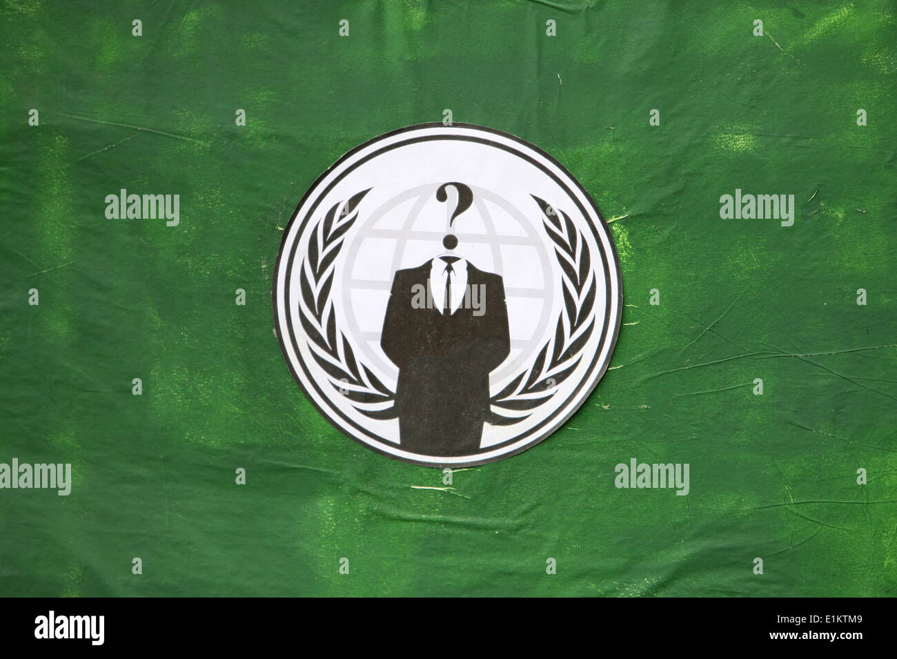 A flag conveying symbolism associated with the Anonymous. The imagery of the 'suit without a head' represents leaderless organiz - Stock Image