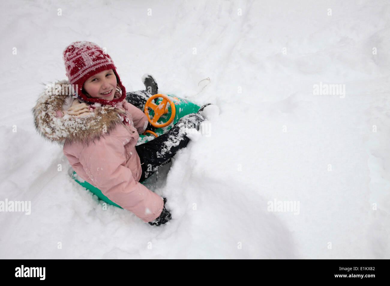 Girl on a sleigh - Stock Image