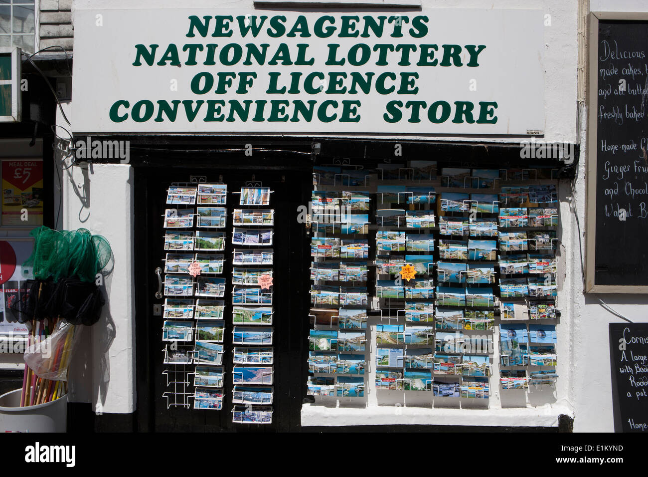 Post cards on the pavement out side a gifts shop in the cornish seaside town of Mevagissey Stock Photo