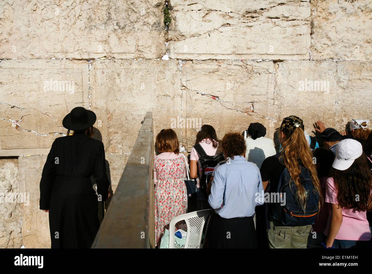 Man and Women Praying separately at Western Wall - Stock Image