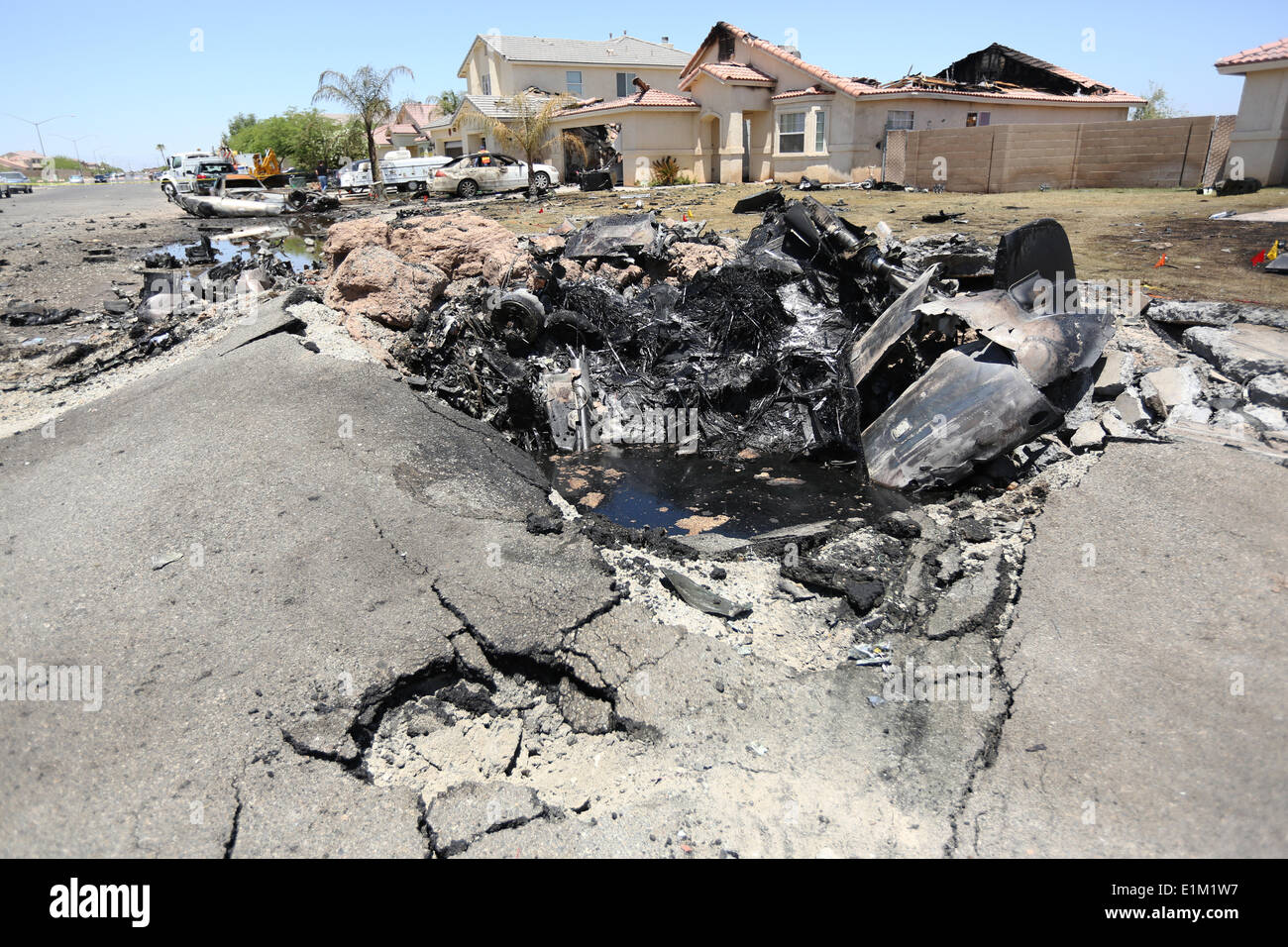 Remains of a US Marine Corps AV-8B Harrier fighter aircraft that crashed in a housing development June 5, 2014 in Imperial, California. Eight homes were evacuated with three destroyed but no injuries reported. - Stock Image