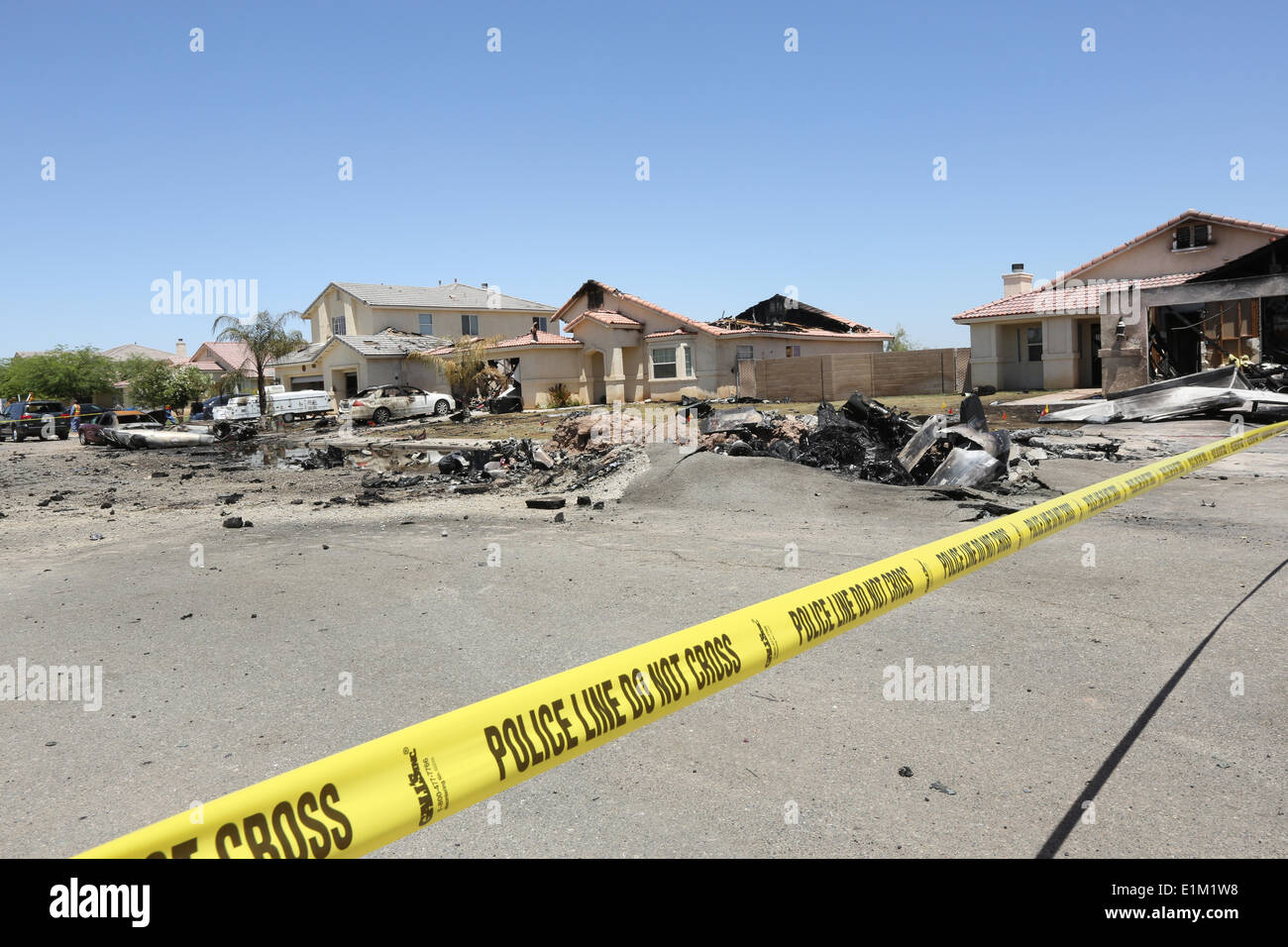 Homes damaged when a US Marine Corps AV-8B Harrier fighter aircraft crashed in a housing development June 5, 2014 in Imperial, California. Eight homes were evacuated with three destroyed but no injuries reported. - Stock Image