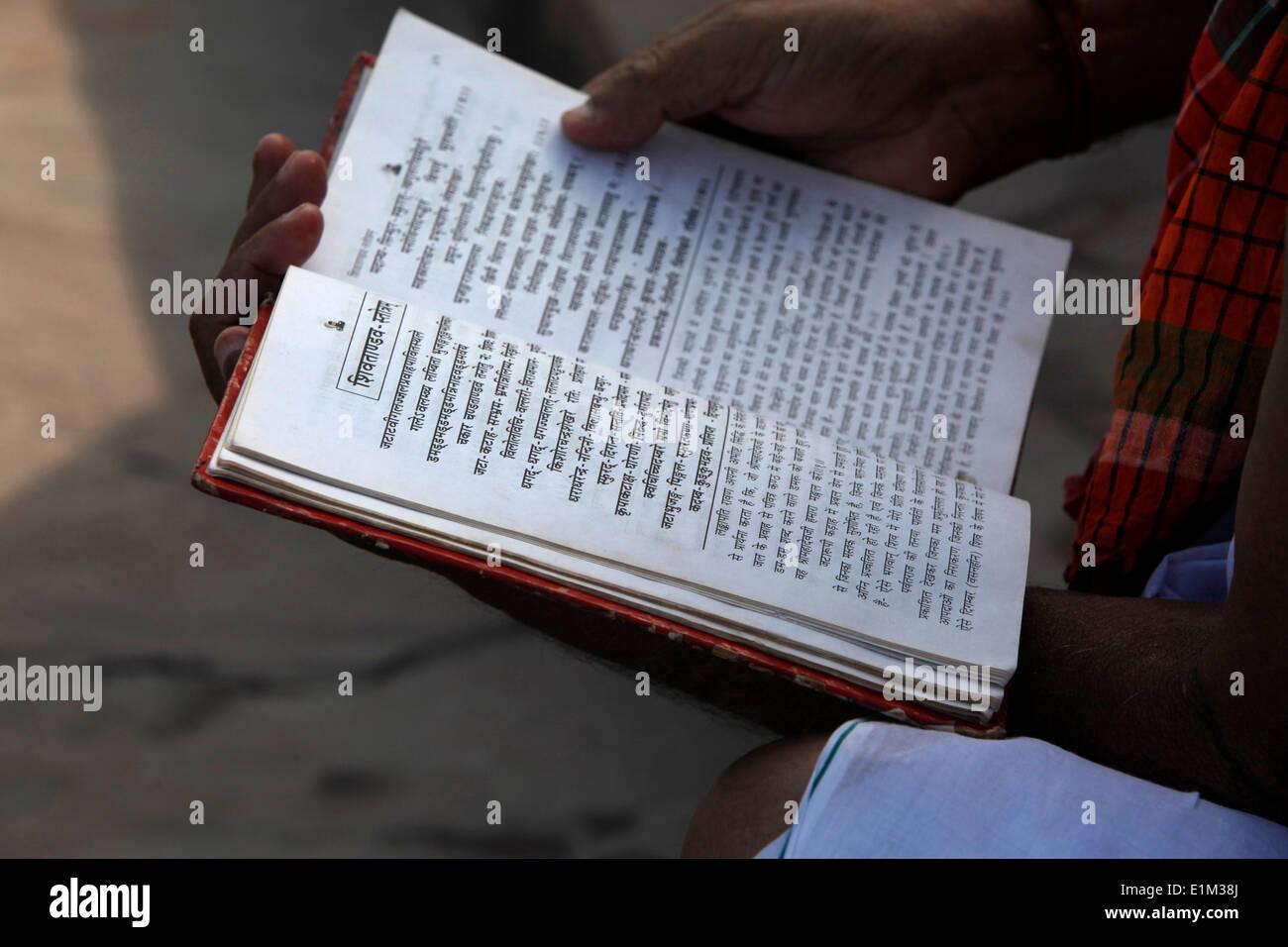 Hindu reading Shiva Chalisa, a prayer for Lord Shiva - Stock Image