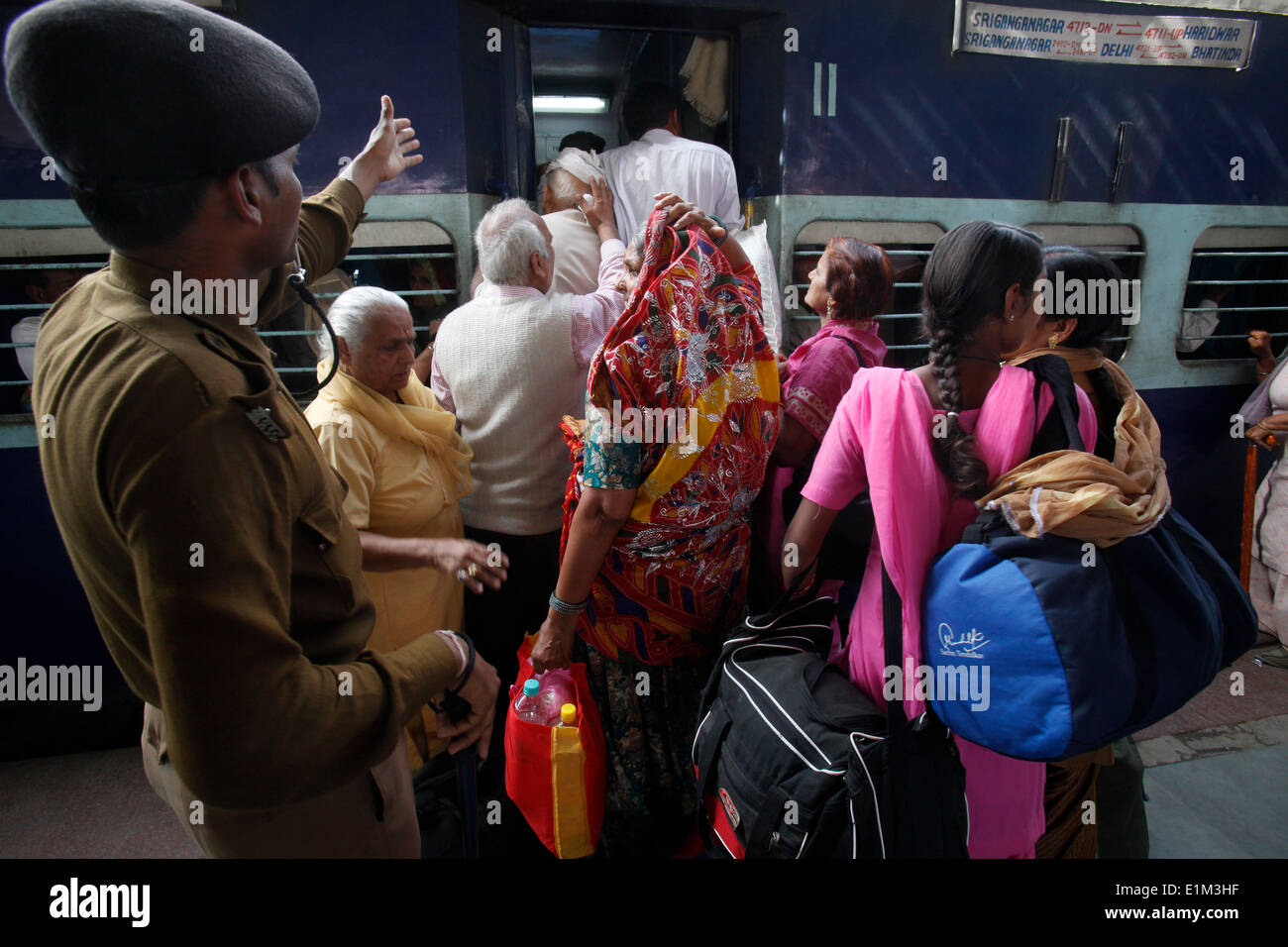 Passengers boarding a train during the Kumbh Mela in Hardwar - Stock Image