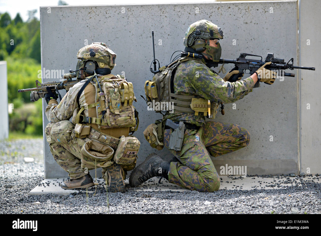 Special operation forces from nine different nations participate in the International Special Training Center advanced close quarter battle course at the 7th Army Joint Multinational Training Command June 5, 2014 at Grafenwoehr Training Area, Germany. - Stock Image