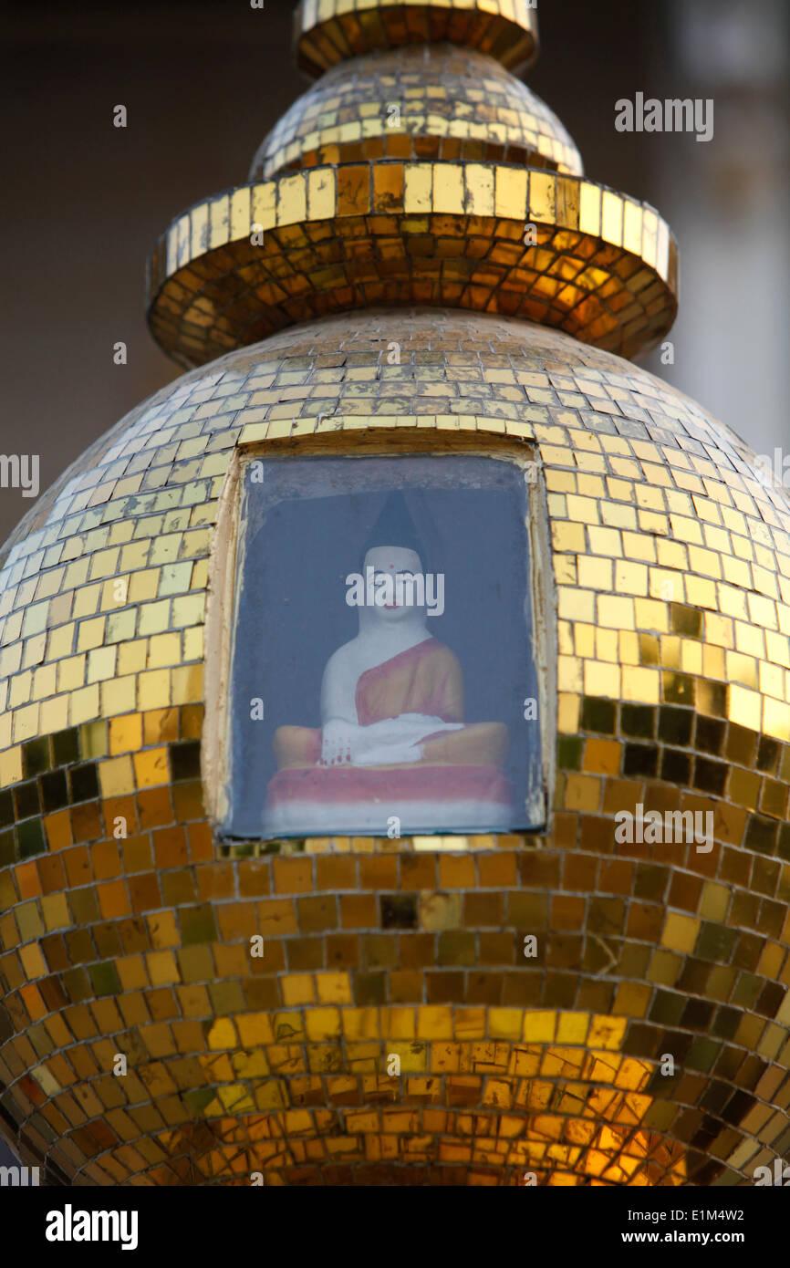 Enclosed Buddha at Wat Svay Porper - Stock Image