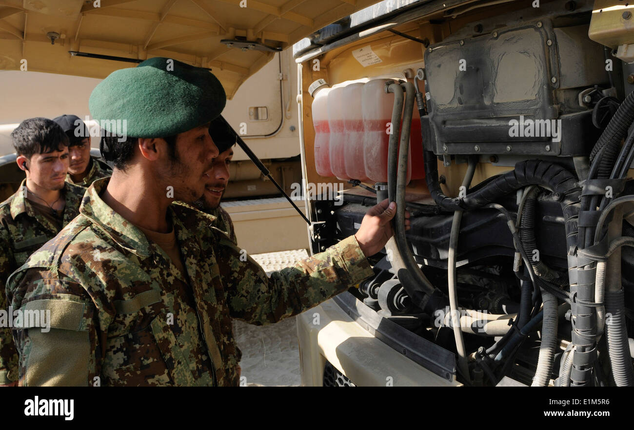 Afghan National Army (ANA) soldiers with the 201st Corps perform preventive maintenance checks and services on a dump truck Jan - Stock Image
