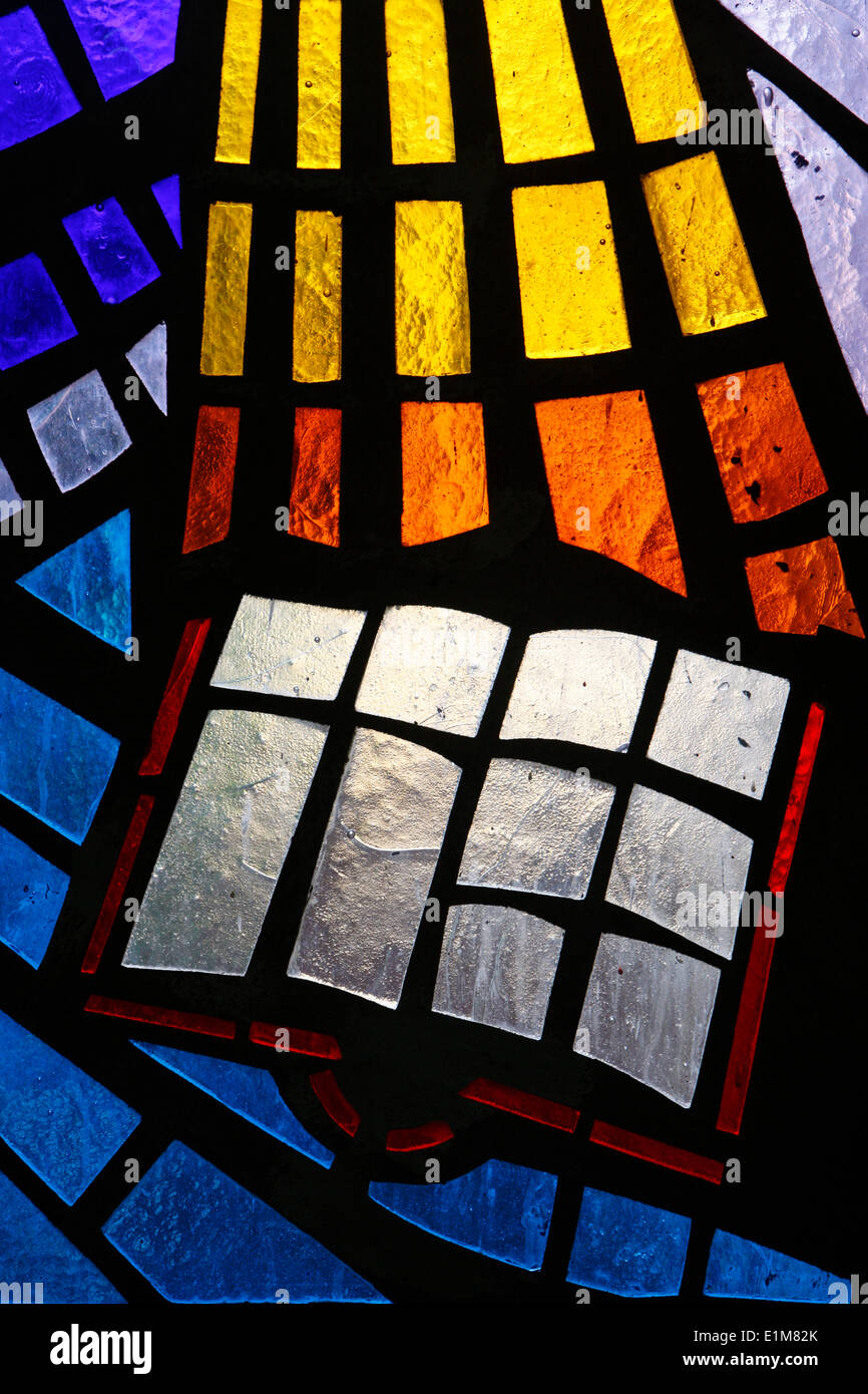 Holy bible depicted on stained glass - Stock Image