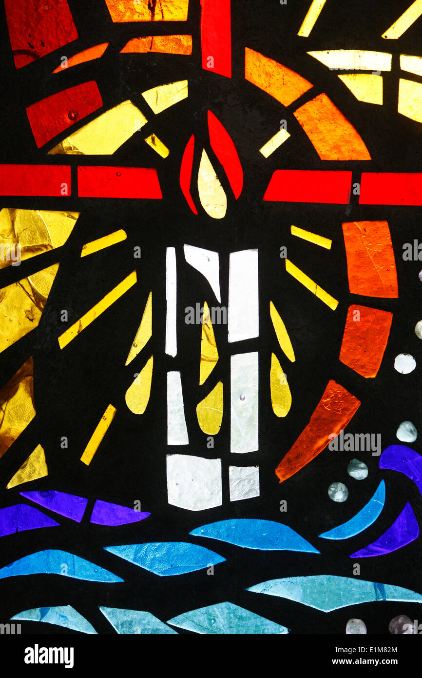 Candle depicted on stained glass - Stock Image