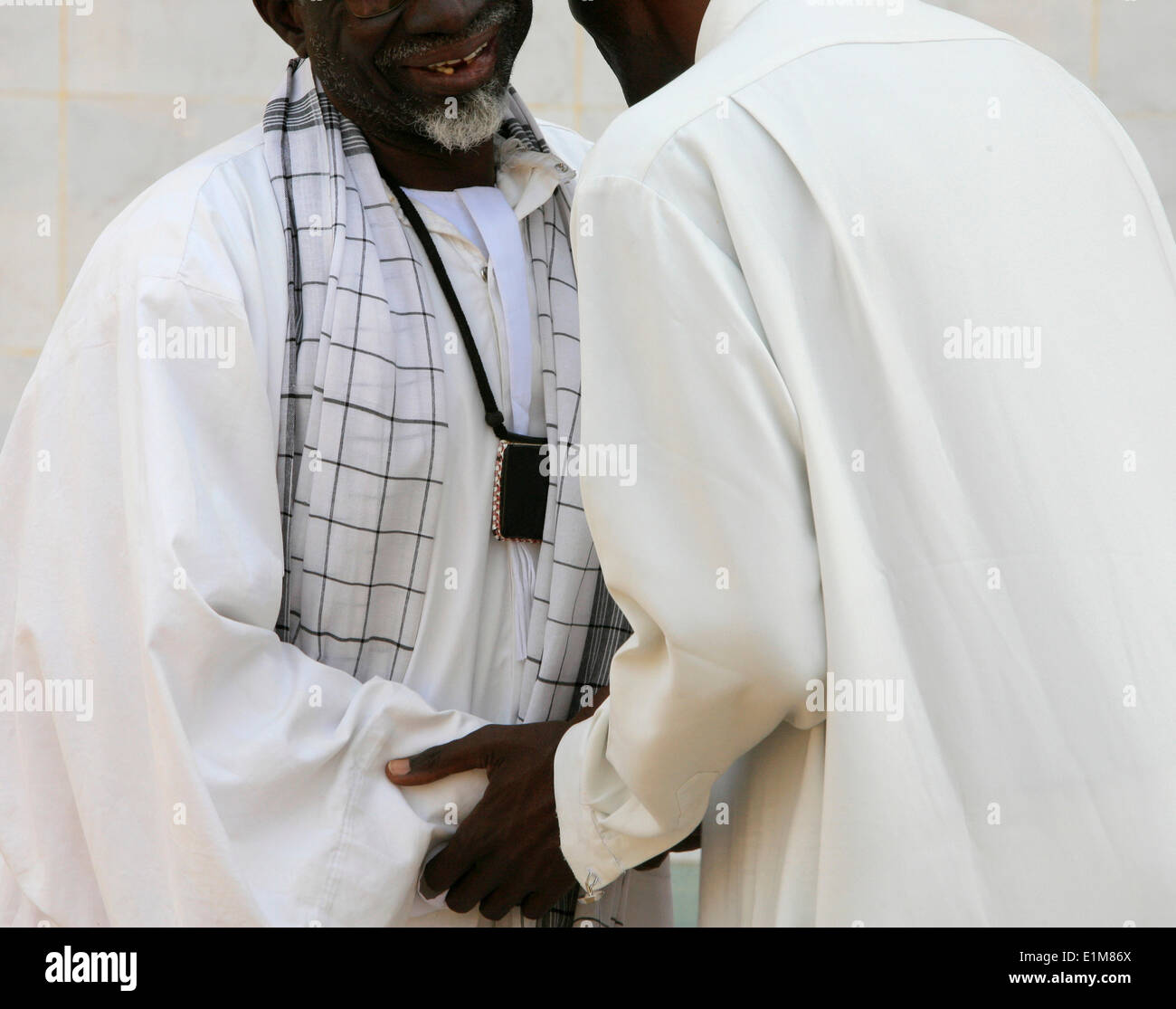 Muslims greeting each other stock photo 69901634 alamy muslims greeting each other m4hsunfo