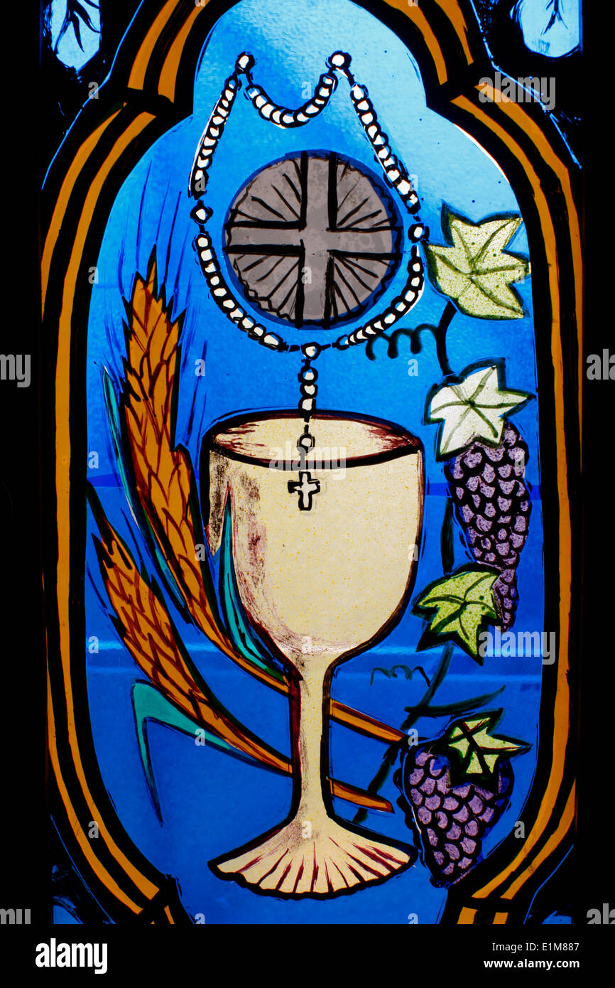 Christian symbols depicted on stained glass - Stock Image